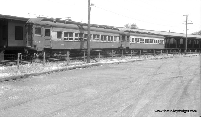 Chicago Aurora & Elgin 407 and 432 in Forest Park in April 1955.