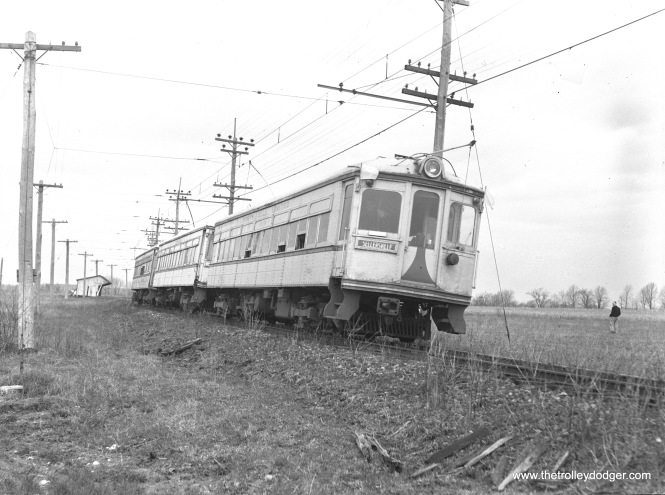 "Lehigh Valley Transit car 702 is part of a three-car fantrip circa 1950 or 51 at stop #96 in Quakertown, Pennsylvania. This was in the waning days of the Liberty Bell Limited interurban between Allentown and Norristown. The ""Bell"" stopped running on the Philadelphia & Western's Norristown High-Speed Line in 1949."