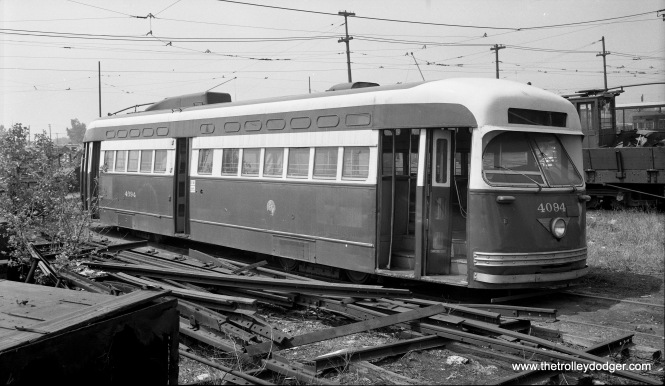 "CTA 4094 in dead storage at South Shops on June 30, 1955. Postwar Pullmans were an endangered species by then, practically all having been scrapped as part of the CTA's ""PCC Conversion Program."" I believe the date is correct; however George Trapp says, ""Last Pullman PCC's to be sent off to St. Louis were the oldest while the newest were sent first, 150 cars in series 4172-4371 went in 1953 with the rest in early 1954."""
