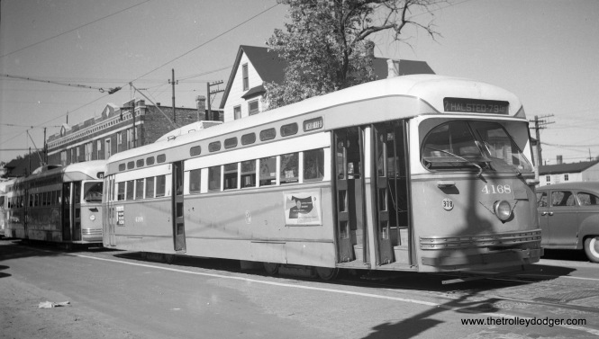 CTA PCC 4168 is seen in 1949, signed for Route 42 - Halsted-Downtown (note the side sign says Halsted-Archer-Clark). There is a Route 8 - Halsted car behind it. The location is on Emerald south of 79th.