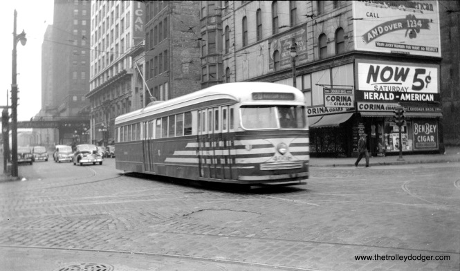 "CTA 4008, in ""tiger stripes,"" is on Route 20 - Madison in March 1948. Notice the sign advertising the Chicago Herald-American, which at this time was owned by the Hearst Corporation. It was sold to the Chicago Tribune in 1956."