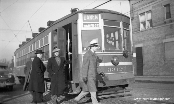 Some passengers are getting off CSL 3312, which is running on the Damen Avenue extension. This gives you an idea of how some men dressed back in the 1940s when it was cold out.