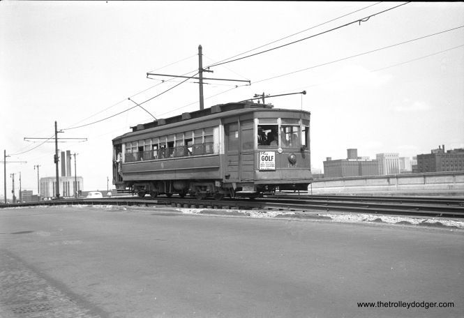 CTA 407, signed for the Museum Loop, is on Roosevelt Road in August 1949.