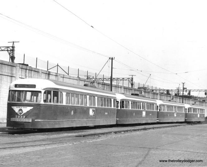 Four CTA prewar PCCs, led by 7033, are lined up on Cottage Grove at 115th in the early 1950s.