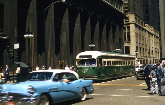 CTA PCC 7184 is southbound on Clark Street on July 9, 1957. I realize that some people might not like this photo, since it is not perfect and part of the streetcar is blocked by a moving vehicle. But such pictures do give you a sense that these were vehicles in motion.