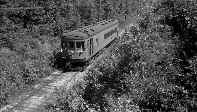 "Indiana Railroad 375, probably on a 1938-40 fantrip. Don's Rail Photos: ""375 was built by St Louis Car Co in 1926 as Indiana Service Corp 375. It was ass1gned to IRR as 375 in 1932 and rebuilt as a RPO-combine in 1935. It was sold to Chicago South Shore & South Bend in 1941 as 503 and used as a straight baggage car. It was rebuilt in 1952 with windows removed and doors changed."""
