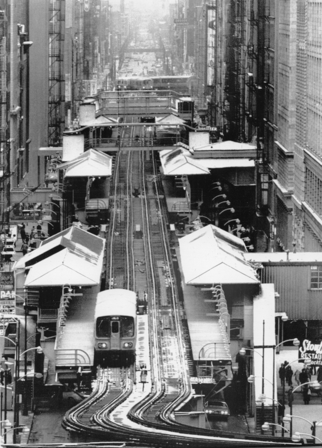 "A dream that fortunately did not come true: CHICAGO'S LOOP ELEVATED TRACKS TO GO January 4, 1974 - This is a view looking south of the Elevated tracks of Chicago's CTA system on Wabash Avenue. This section along with other portions that formed ""The Loop"" is scheduled to be taken down sometime in the future with the building of a subway that is to take its place."