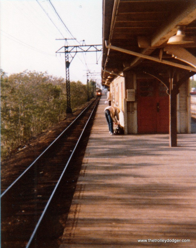 Looking north at the Kensington station, as a South Shore Line train approaches in 1975.