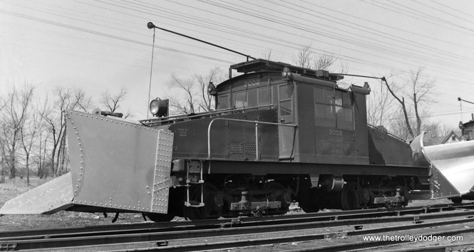 CA&E loco 2002 with snow plow attached. It was built by G. E. in 1920.