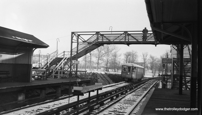 "Philadelphia & Western ""Strafford"" car 170, coming into a station circa 1938. Kenneth Achtert adds, ""The photo of Philadelphia & Western 170 is arriving at Villanova station, outbound. This is the last station before the split where the Norristown line diverged from the Strafford line. The small platform between the two tracks was used to allow passengers from an inbound Norristown car to transfer directly to an outbound Strafford car without having to go up and over the overpass shown. This would also work from an inbound Strafford car to an outbound Norristown car. I don't know how many passengers actually made such a trip, but I do remember seeing such transfers made."" The last train ran on the Strafford Branch on March 23, 1956."