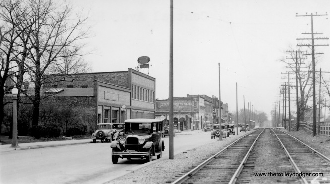 The information on the back of this picture says we are looking south from Central Avenue in Highland Park. At right, thiee are North Shore Line tracks on the old Shore Line Route. A small shelter is visible at right. This picture is circa 1930. The area the North Shore Line once occupied is now a parking lot.