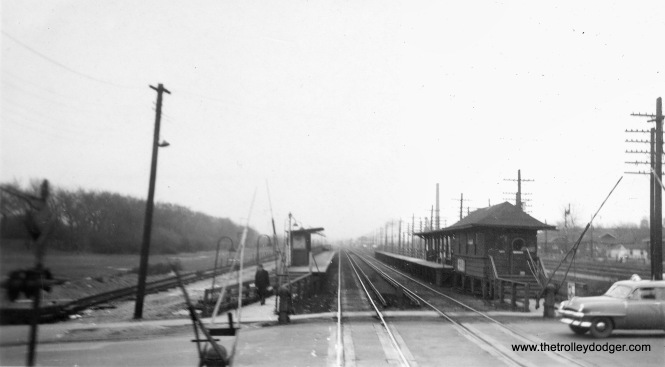 "Although this is not the sharpest picture, it does show the Austin Boulevard station on the Garfield park ""L"", probably circa 1954. We are looking east. To the left, you can see the southern edge of Columbus Park. At the far left, temporary tracks are already being built, which the ""L"" would shift to in this area on August 29, 1954. This is the present site of the Eisenhower Expressway."
