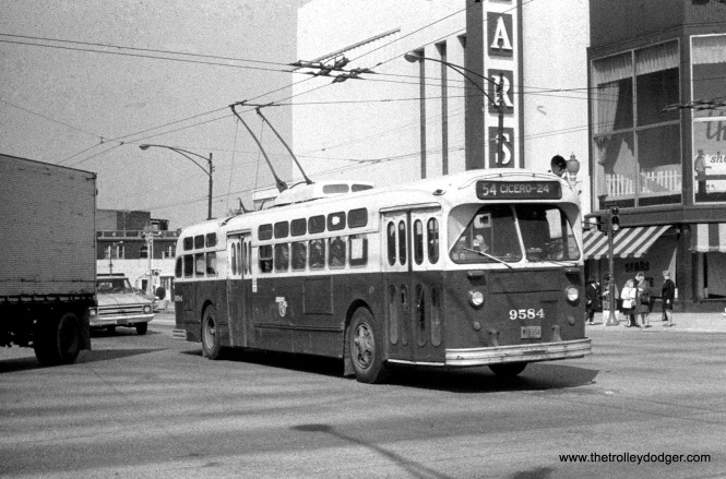 "CTA trolley bus 9584 at ""Six Corners"" (Cicero, Milwaukee and Irving Park) in April 1969, heading south on Route 54 - Cicero Avenue. Who would have thought when this picture was taken that this would someday become the very last Sears store in Chicago?"