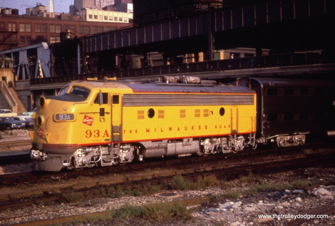 "Milwaukee Road loco 93A shoves an eastbound ""Scout"" under Lake Street. The view looks east-southeast."