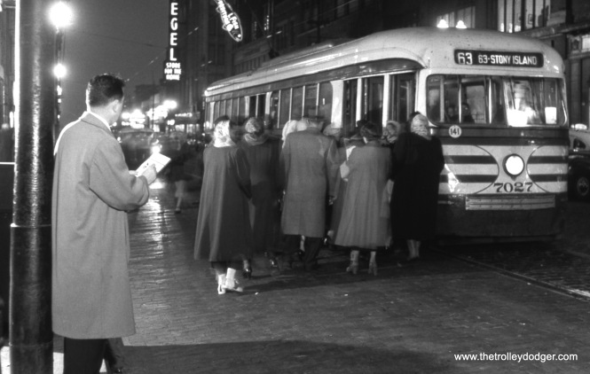 CTA 7027 is picking up a crowd of shoppers as it heads eastbound at 63rd and Halsted, sometime between 1948 and 1951.
