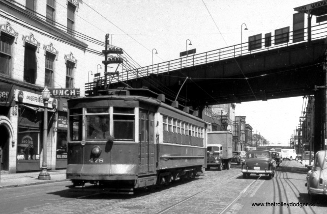 "CTA 478 is westbound on 63rd Street at Harvard in 1952. That's the old Harvard ""L"" station on the Englewood branch at rear, which closed in 1992."