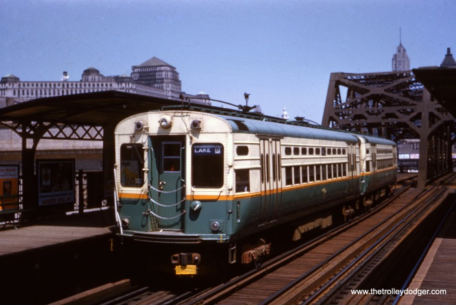 "On June 26, 1960 a pair of CTA single-car units went out on a portion of the Lake Street ""L"", but apparently did not go on the ground-level portion of the route. Here, we see the train heading westbound at Clinton and Lake. (Charles L. Tauscher Photo)"