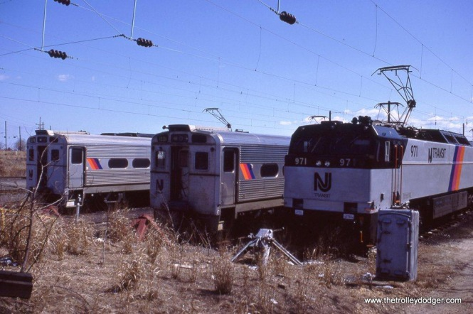 Photo 1. NJT Arrow MUs 1375 & 1501 share yard space with E-60 #971 at South Amboy, NJ in 1984.