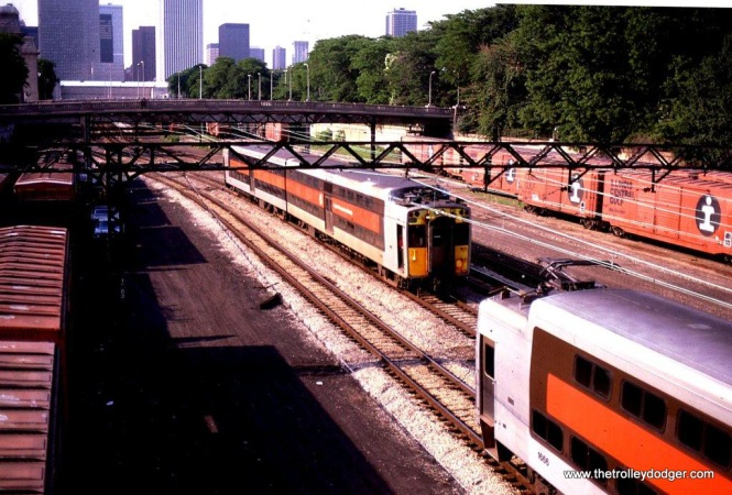 Photo 1. RTA/ ICG Highliner MU trains pass near the Randolph Street Terminal, Chicago, IL. 6-23-82.