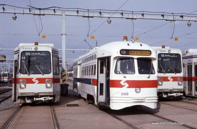 SEPTA Kawasaki car #9023 & PCC #2129 at the Elmwood Avenue car barn in Philadelphia, PA in January of 1992.