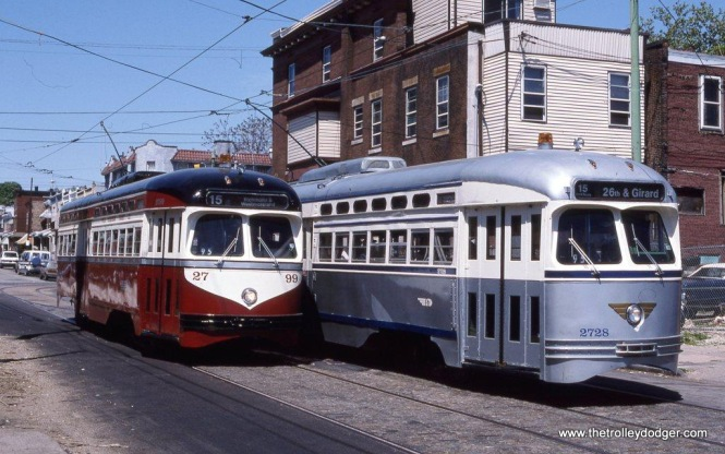 On May 7, 1995 Wilmington Chapter NRHS chartered SEPTA PCC #2799 in a Red Arrow paint scheme and PCC #2728 in the colors of the Philadelphia Transportation. The two brightly colored cars were posed side by side on Girard Avenue at 63rd Street in the Philadelphia neighborhood of Haddington.