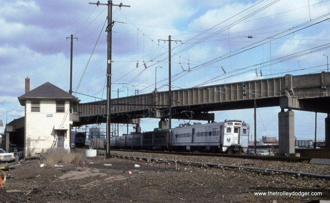 Photo 11. Arrow III MU #1483 leads a Trenton bound train at HUNTER Tower, Newark NJ. 1-26-97.