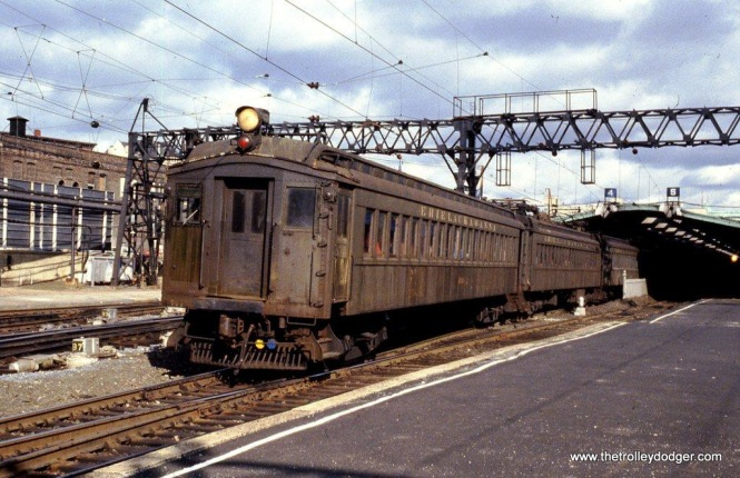 Photo 11. Looking a little shabby, Ex-DL&W MUs depart Hoboken Terminal. 10-3-81.