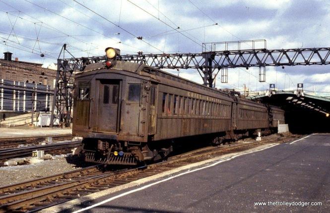 Photo 11. Looking a little shabby, Ex-DL&W MUs depart Hoboken Terminal. 10-3-81.