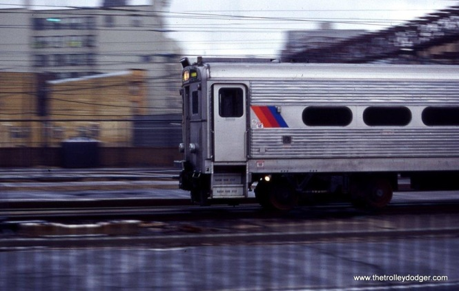 Photo 13. An Arrow III MU train departs Hoboken Terminal in this low light pan shot. 3-11-00.