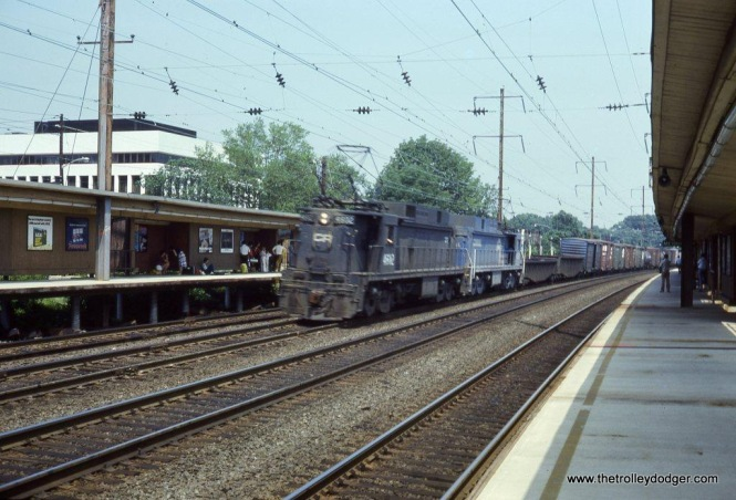 Conrail E-33 #4602 leads a long freight through the Metropark station at Iselin, NJ. 8-14-78. From my very first roll of color slide film.