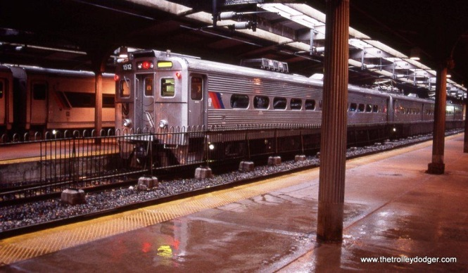 Photo 15. One more from that cold rainy March day in 2000. NJT Arrow III #1512 will soon be departing the Hoboken Terminal and head out into the damp evening.