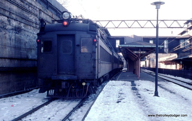 Photo 15. NJDOT/Conrail Ex-DL&W MU on a Gladstone Line train at Summit, NJ in January of 1981. At this time Gladstone Branch trains departed Hoboken coupled to the rear of Morristown trains. At Summit the Gladstone section was uncoupled and departed as a separate train. Today's ARROW MUs are semi-permanently coupled preventing this type of operation. Gladstone passengers must now change trains at Summit, no more one seat ride.