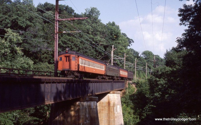Photo 17, 18, & 19. The scenic highlight of the Gladstone branch is the high bridge over the Passaic River at Millington, NJ. Here are three photos of the Ex-DL&W MUs crossing the bridge in August of 1984, just before the DC current was shut off and all of these cars retired.