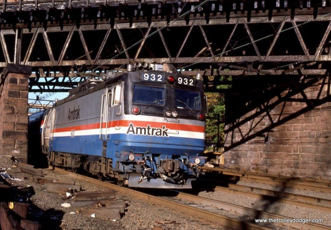 Photo 18. In October of 1997 I made a trip to Rye, New York to photograph Amtrak and Metro-North trains under the New Haven Railroad's unique triangular catenary. The first photo I took was of the train I arrived on, the FAST MAIL powered by Amtrak AEM-7 #932.