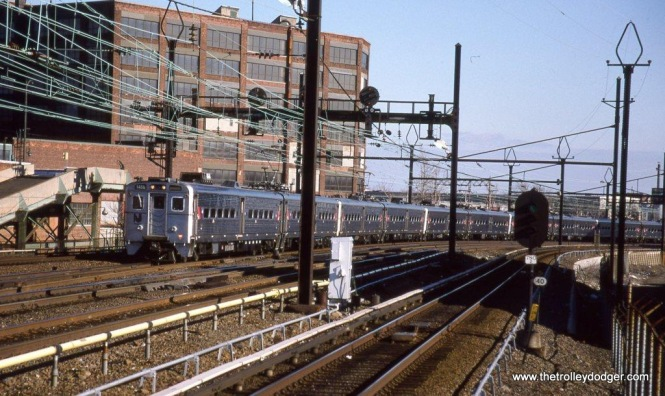 Photo 18. NJT Arrow III MU #1488 leads a long Trenton bound train seen from the Harrison PATH station platform.