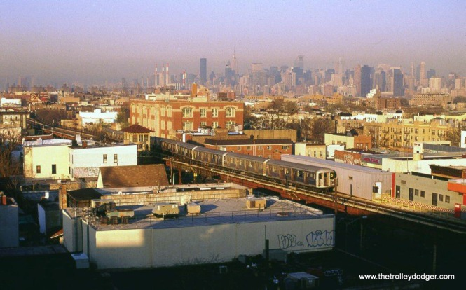"A ""W"" train of R-42 cars near the Ditmers Boulevard station in Astoria Queens, New York, 4-19-05."