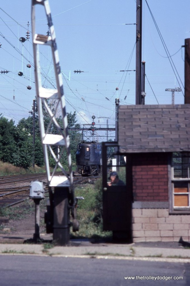Photo 2. The crossing guard takes a little break from manually operating the gates as NJDOT GG-1 #4882 waits for it's next train at South Amboy, NJ in the summer of 1980.