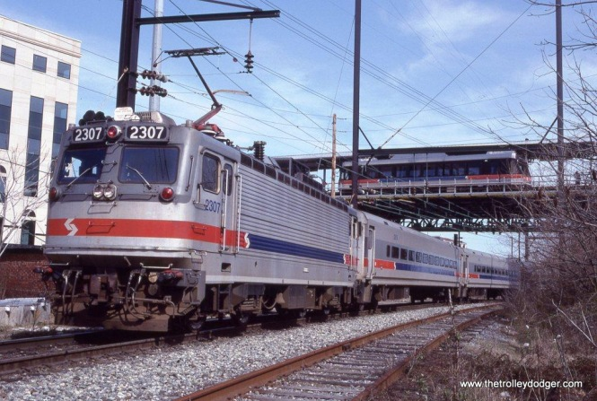 The Philadelphia Chapter NRHS arranged this over & under shot of SEPTA AEM-7 #2307 & P&W N-5 #451 at Norristown, PA on March 29, 1992.