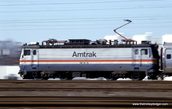 Photo 23. AEM-7 #933 at speed. Linden, NJ. March 1, 1992.