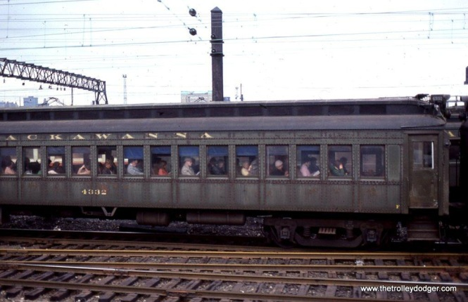 Photo 23. After the day's work the commuters on this train likely feel as weary as the train of Ex-DL&W MUs look. Hoboken, NJ. 3-25-80.