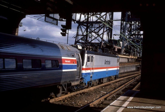 Photo 24. AEM-7 #929 departs Newark, NJ Penn Station 10-29-83.