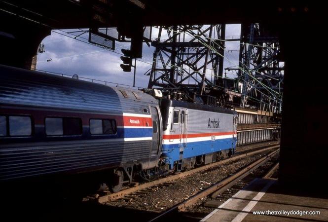 Photo 24. AEM-7 #929 departs Newark, NJ Penn Station 10-29-83.