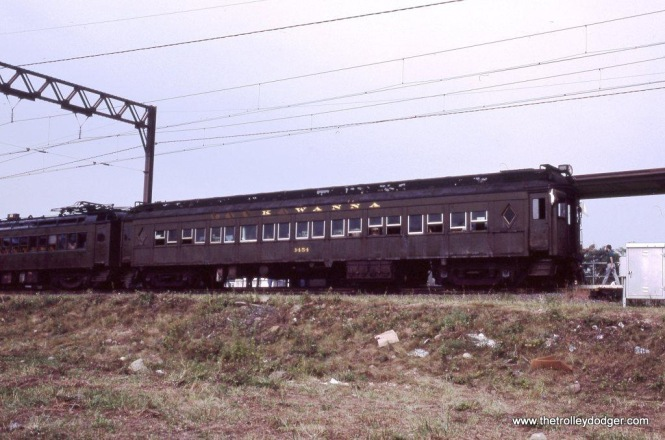 """Photo 25. Whatever adhesive was used to apply the LACKAWANNA lettering to the Polar car was certainly not up to the task. """"K WANNA"""" #3454 is shown during a photo stop at Montclair, NJ."""