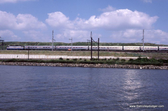 Photo 26. Amtrak AEM-7 912 W/B photographed from a boat on the Passaic River at Kearny NJ.
