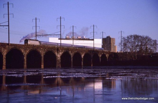 Photo 28 Amtrak AEM-7AC #948 on Keystone Train #661 crossing the Delaware River on the Ex-PRR bridge opened in 1903. Morrisville, PA. 1-10-10.