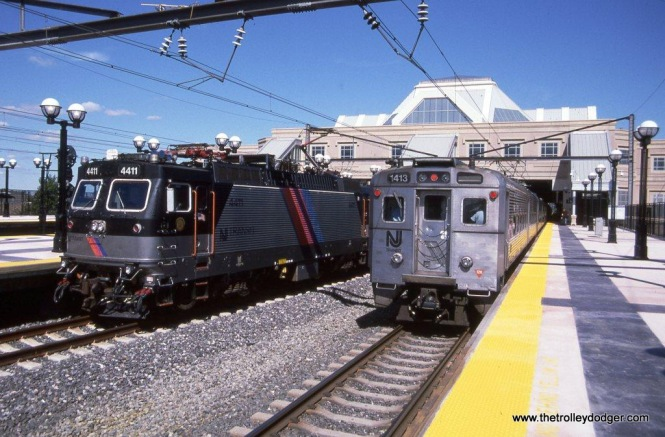 Photo 3. ALP-44 #4411 & Arrow III #1413 at the Secaucus transfer station, Secaucus Junction, NJ, on September 6, 2003.