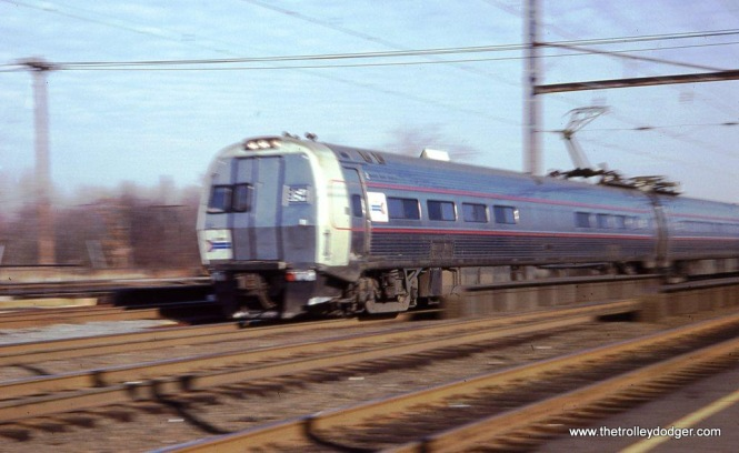Photo 4. In another of my motion blurred action shots, an Amtrak Metroliner MU train speeds through Edison, NJ on December 1, 1979.