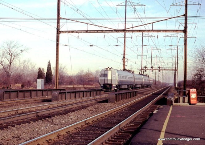 Photo 5. Amtrak Metroliner MU #817 leads a westbound train at Edison, NJ in 1978.