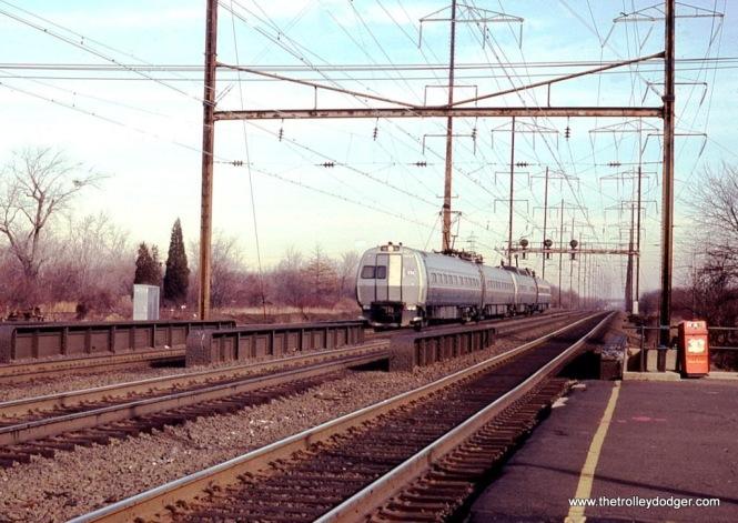 Photo 5. Amtrak Metroliner MU #817 leads a westbound train at Edison, NJ in 1978.
