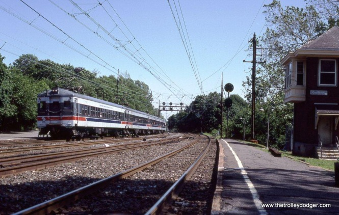 SEPTA Blueliners on a fan trip passing the Ex-PRR interlocking tower at Overbrook, PA on the famed Pennsy Mainline. 6-5-88.
